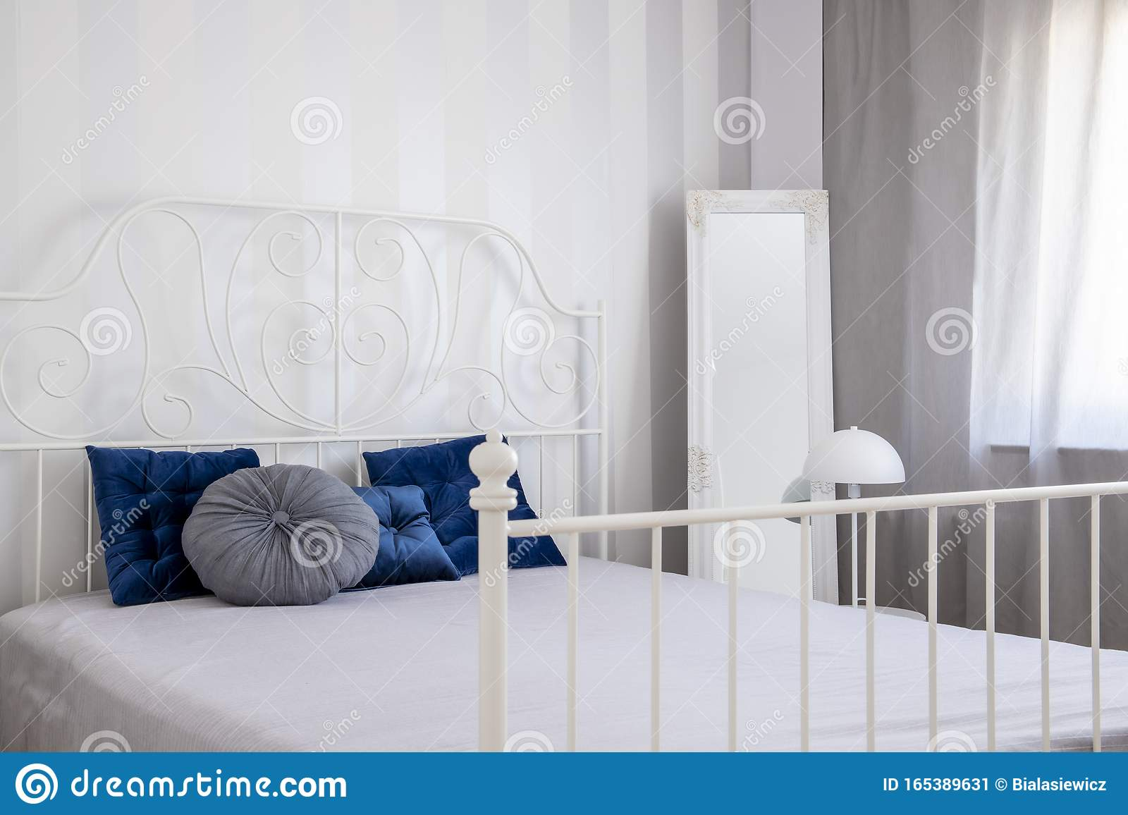 Pillows On White Metal King Size Bed In Small Bedroom Interior Stock Image Image Of King Condo 165389631