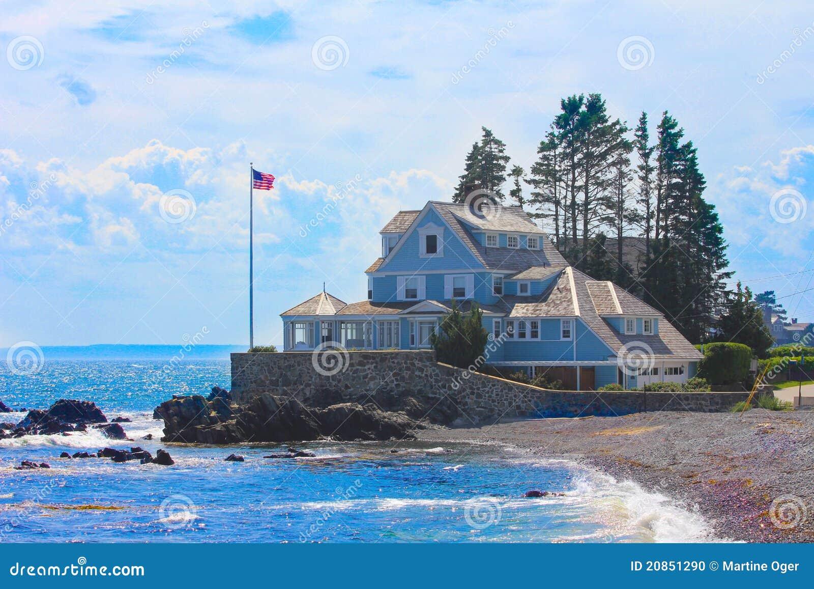 A blue home on the beach.