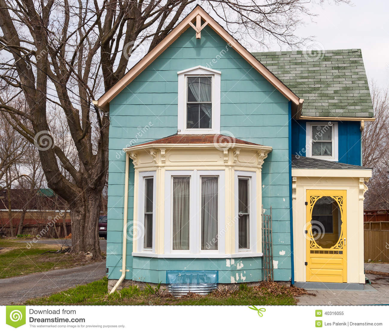 Blue house with bay window stock photo image 40316055 for Window for houses pictures
