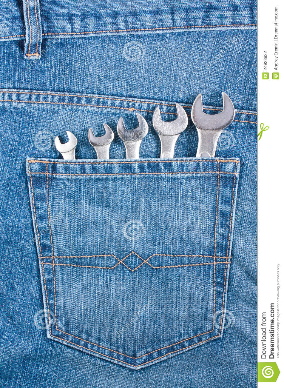 blue jeans pocket with wrenches stock photography image
