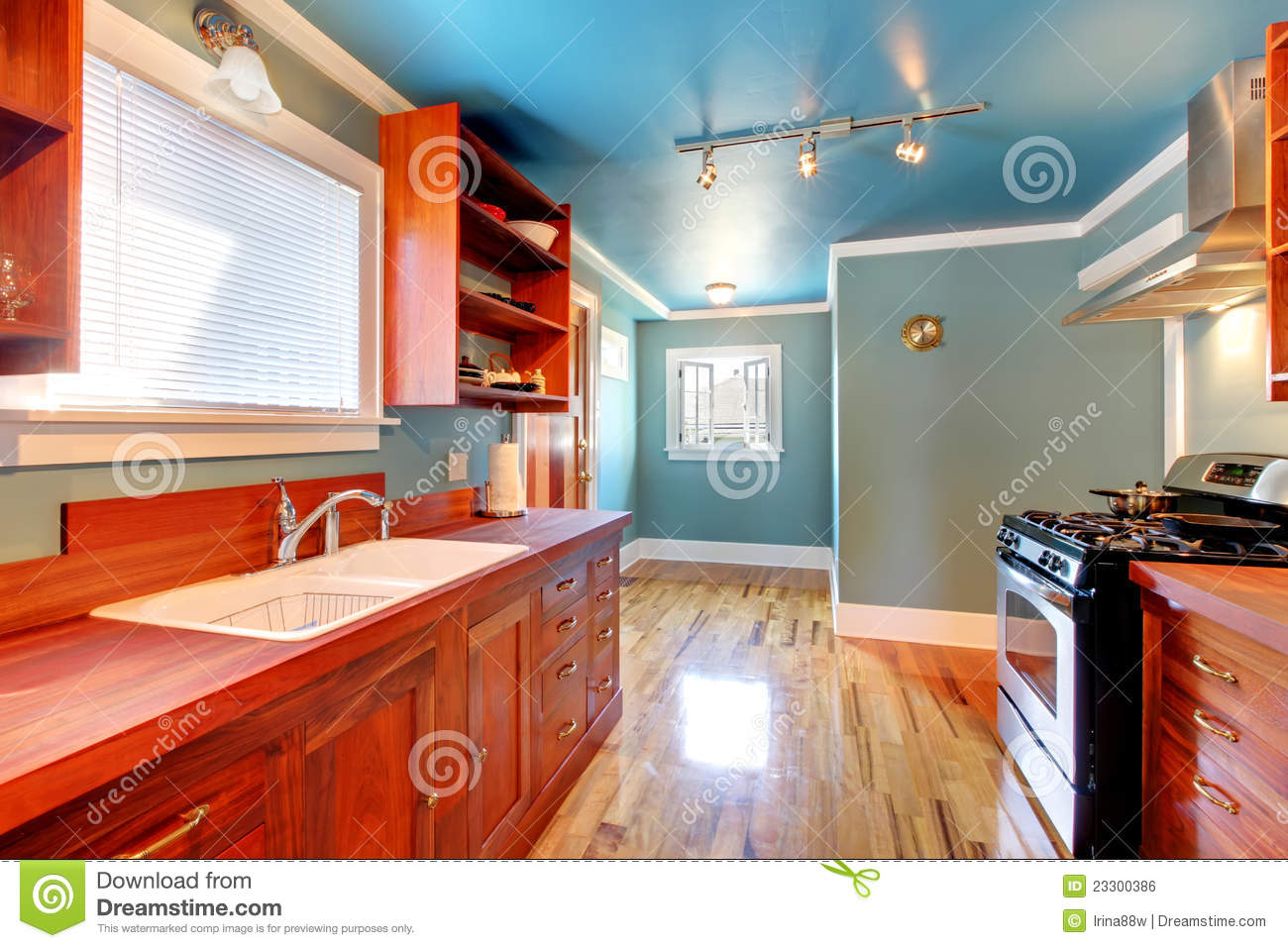 blue kitchen cherry cabinets shiny floor 23300386 jpg