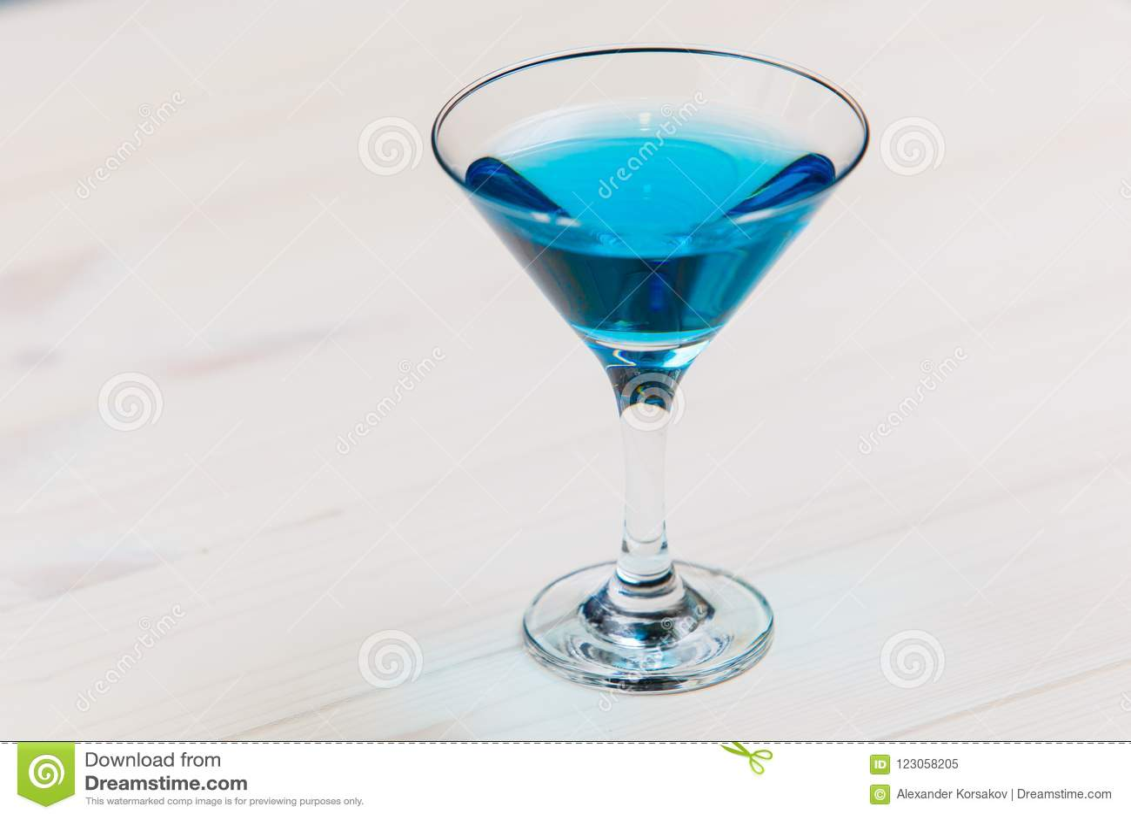 Blue lagoon coctail on white board macro