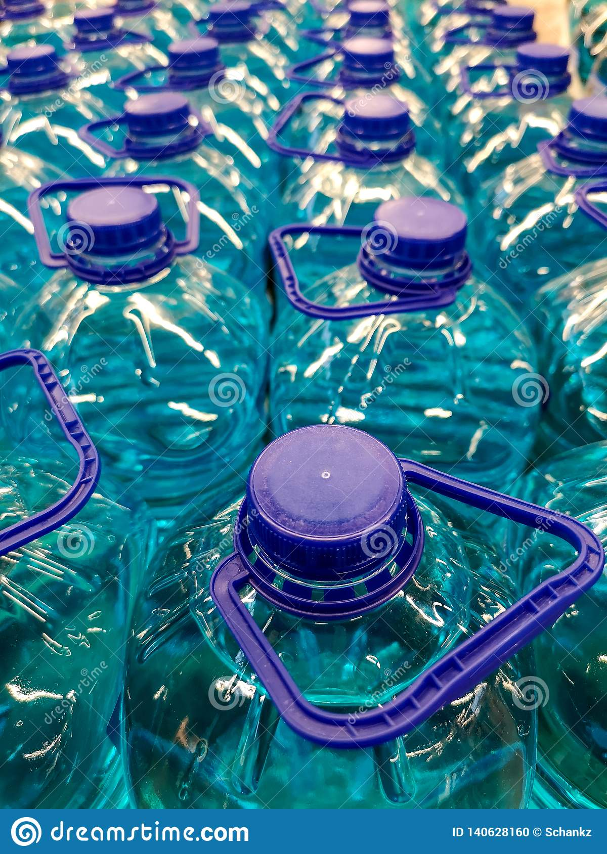 Blue liquid in plastic bottles as a background