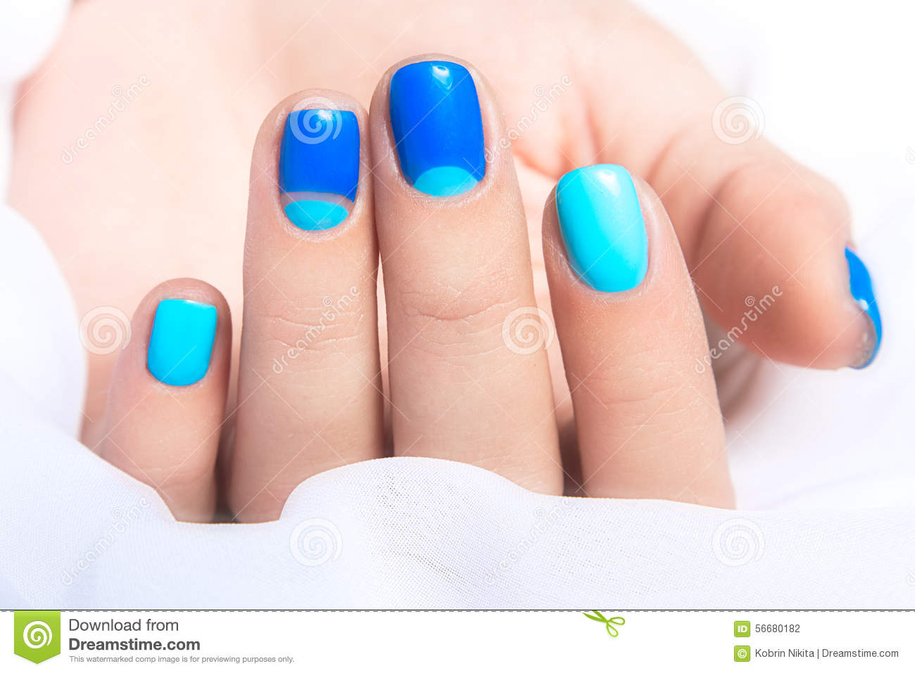 Blue Manicure In Light And Dark Colors Of Lacquer Stock Photo