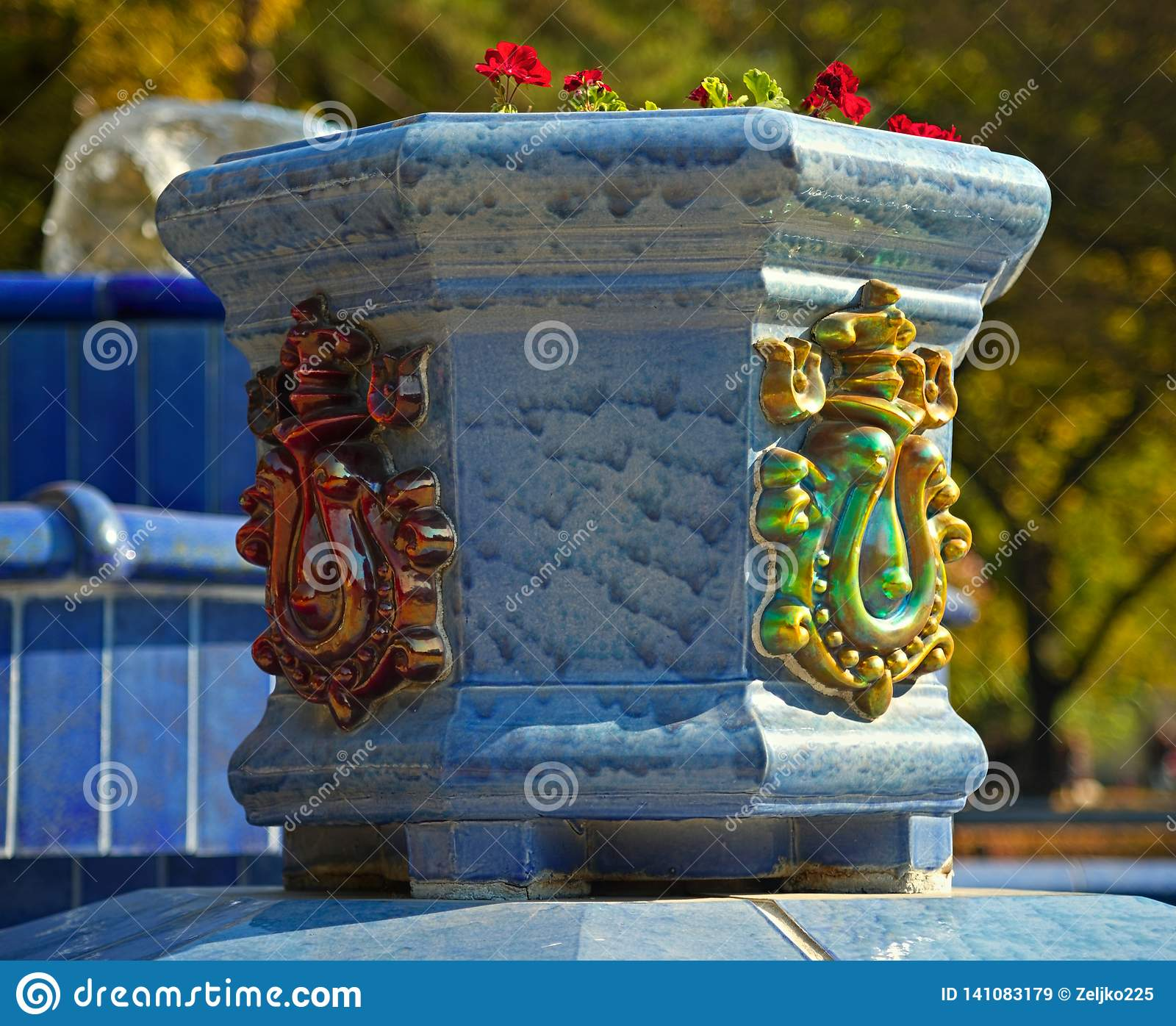 Blue marble flowerpot with decorations and flowers
