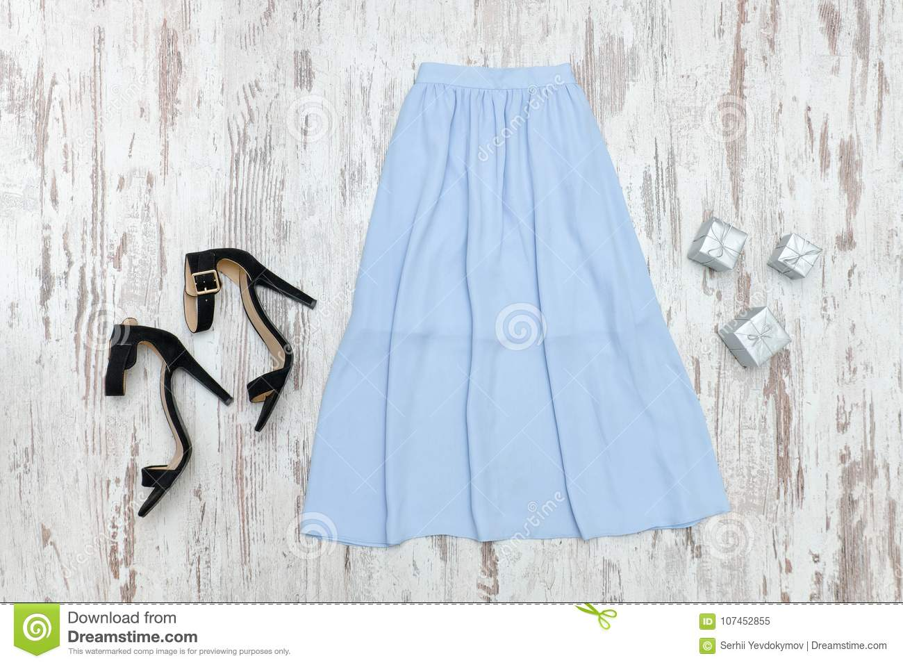 Blue Midi Skirt And Black Shoes  Fashionable Concept Stock