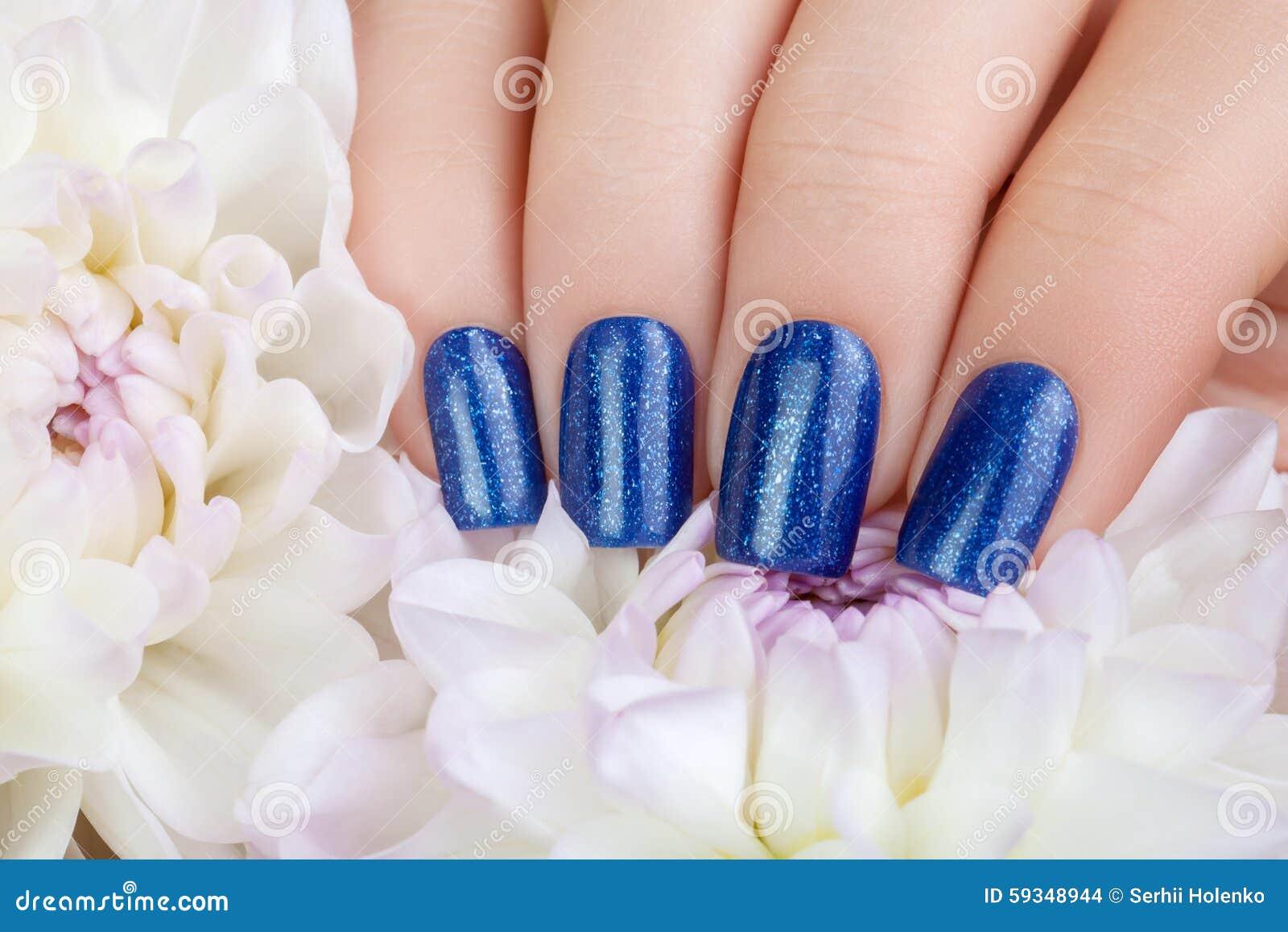 Blue nail polish stock photo image of creative beauty 59348944 download blue nail polish stock photo image of creative beauty 59348944 izmirmasajfo