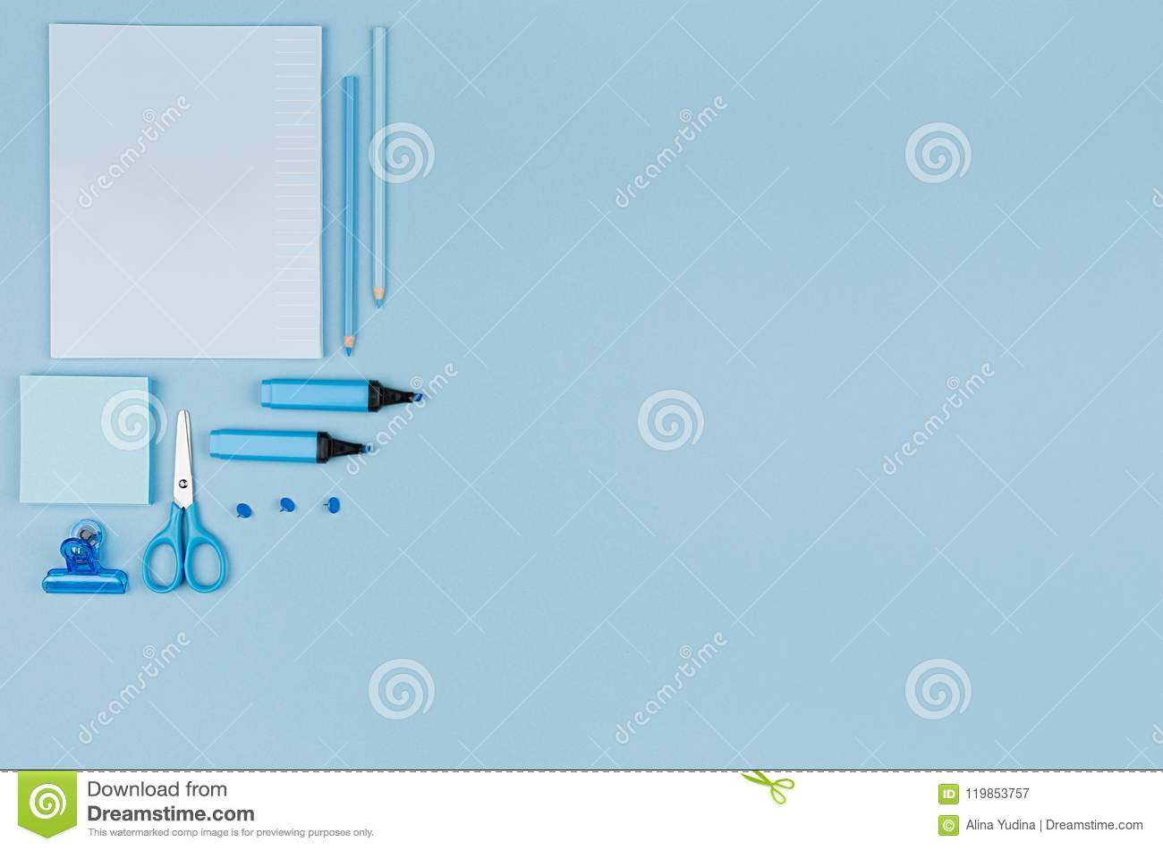 blue office stationery collection on soft pastel blue paper