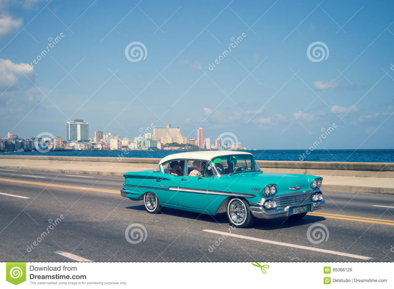Blue Old Classic Cars On The Malecon, The Iconic Seafront Promenade ...