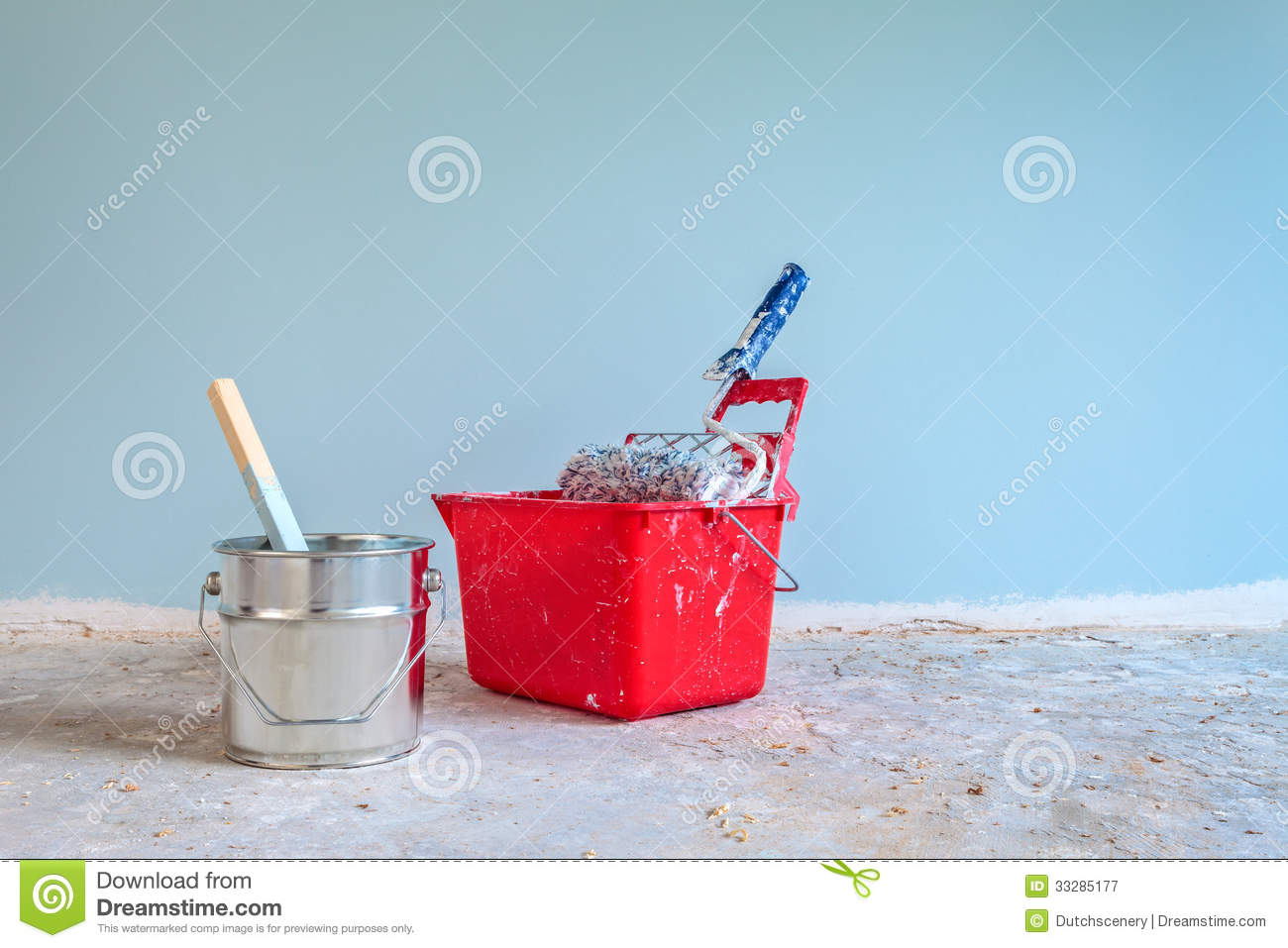 Blue painted wall with painting tools in front royalty for Wall painting utensils