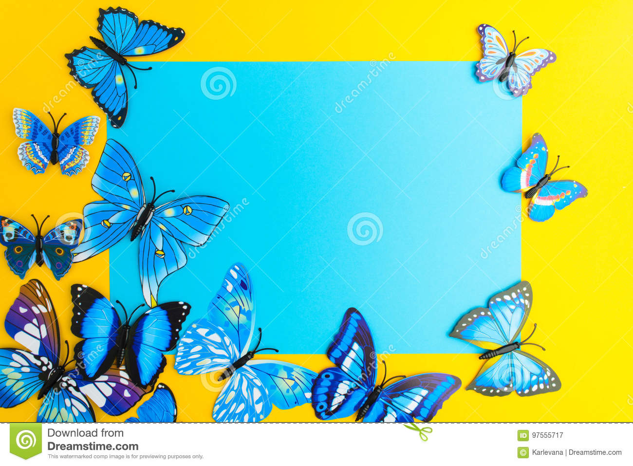 Blue paper with butterfly decoration on yellow background with c