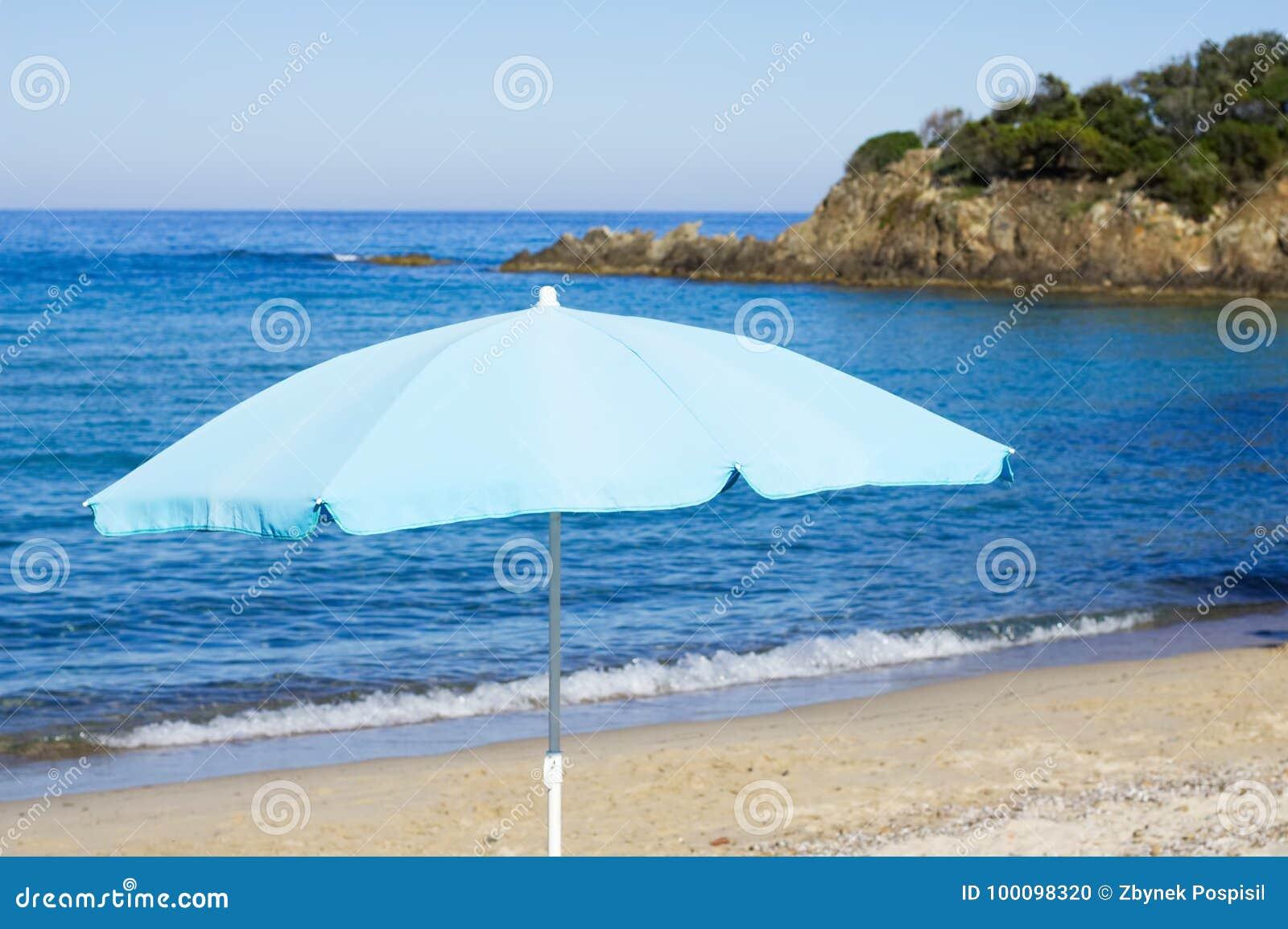 Blue Parasol On Sunny Beach Stock Photo - Image of island 2b21b52490b