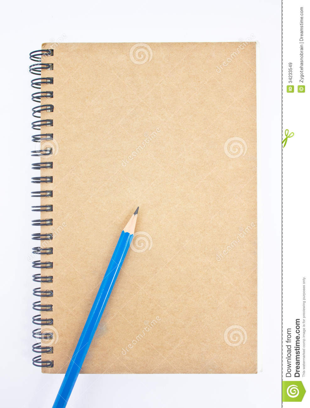 Notebook Cover Background : Blue pencil on brown notebook s cover royalty free stock