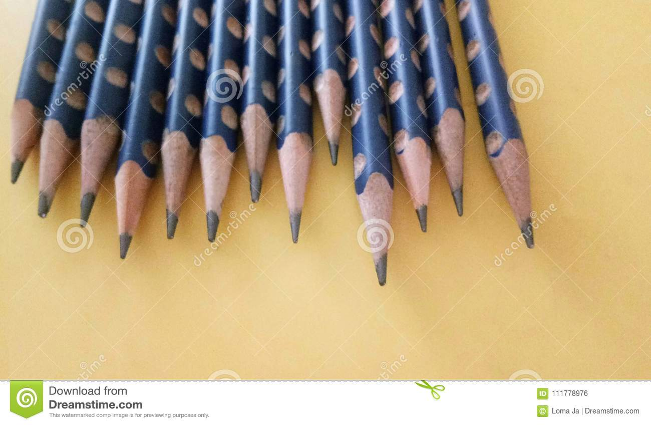 Blue pencils on yellow background