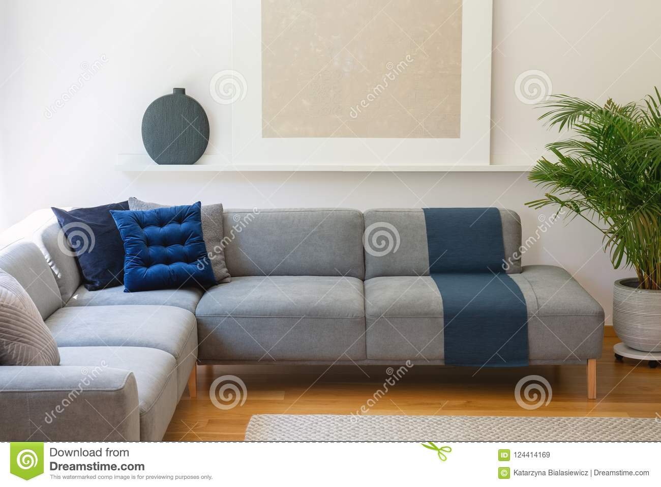 Blue Pillows On Grey Corner Couch In Living Room Interior