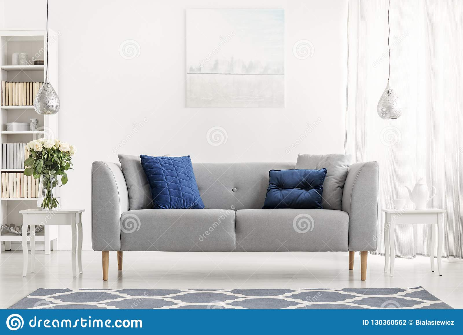 Remarkable Blue Pillows On Grey Couch Next To Table With Flowers In Andrewgaddart Wooden Chair Designs For Living Room Andrewgaddartcom