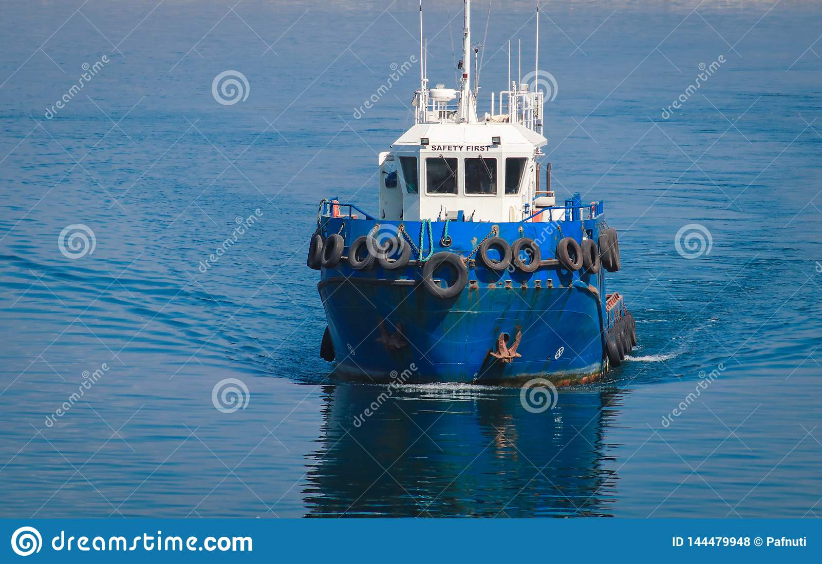 Blue pilot boat enters the seaport of Odessa.