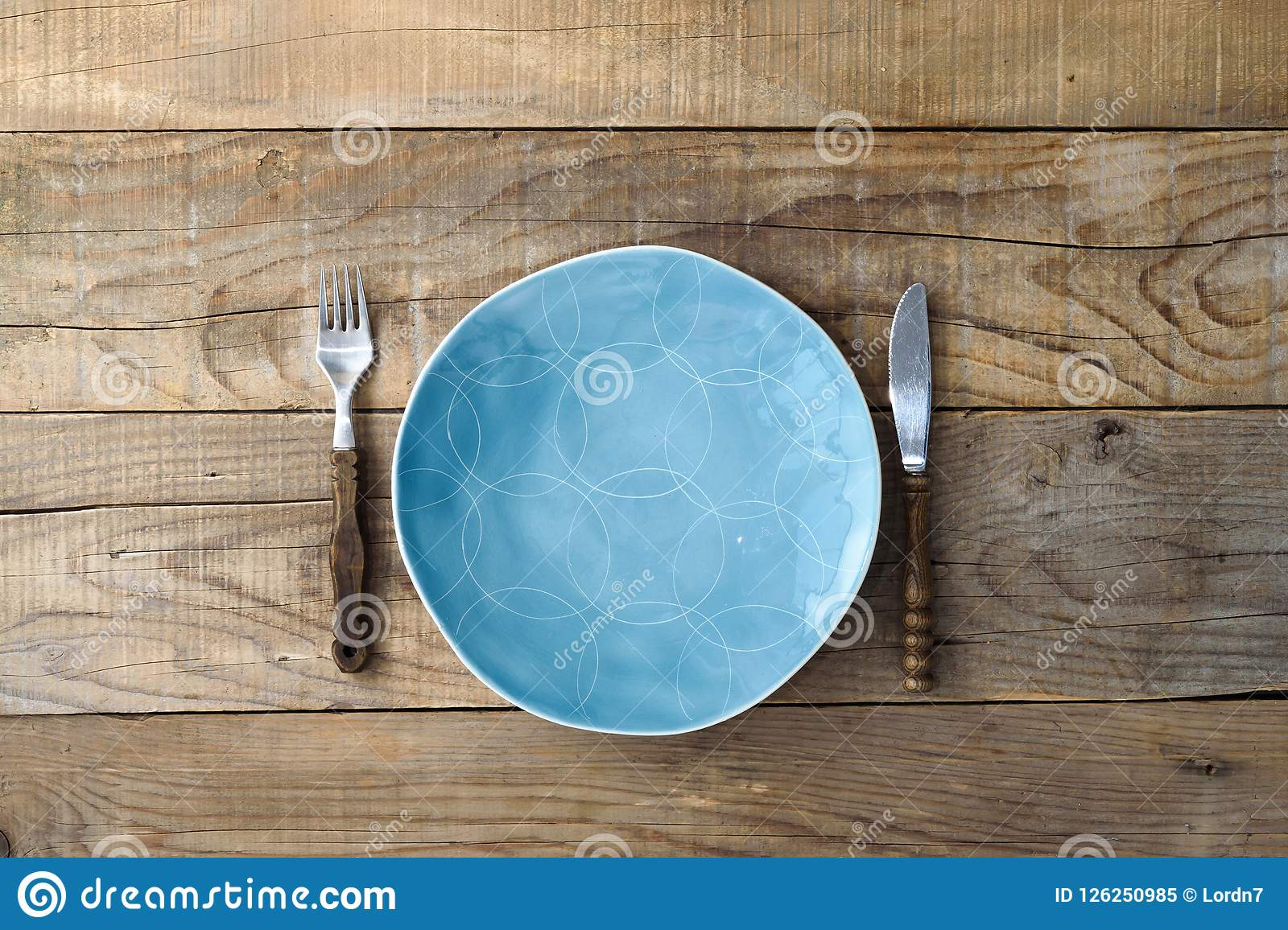 Blue Plate Knife And Fork On Rustic Wooden Table  Dining