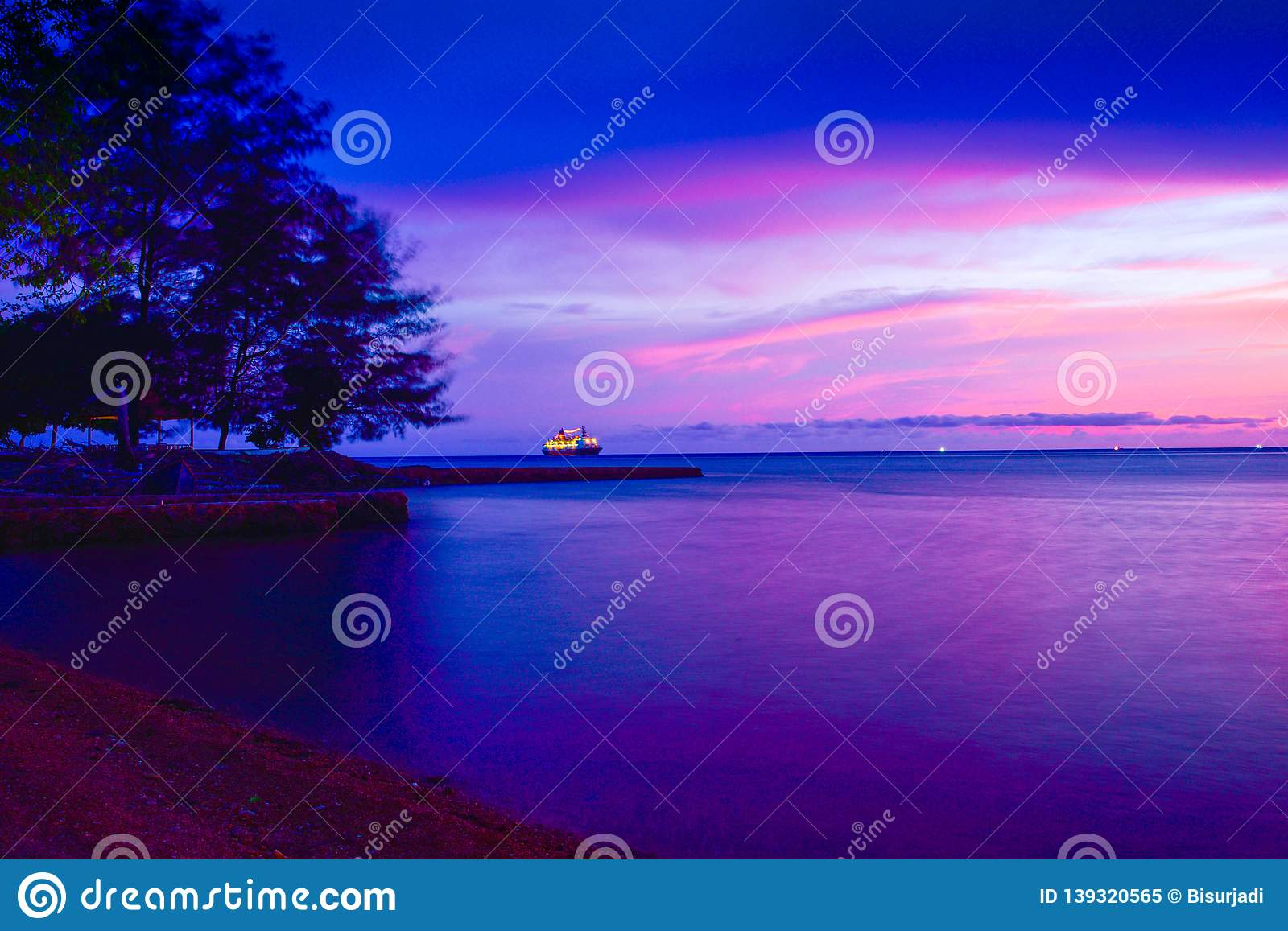 Blue purple sunset at the tropical quiet beach