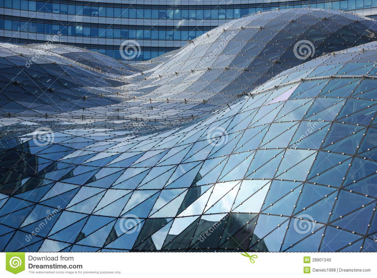 Blue reflections on the roof of modern building. Warsaw. Poland