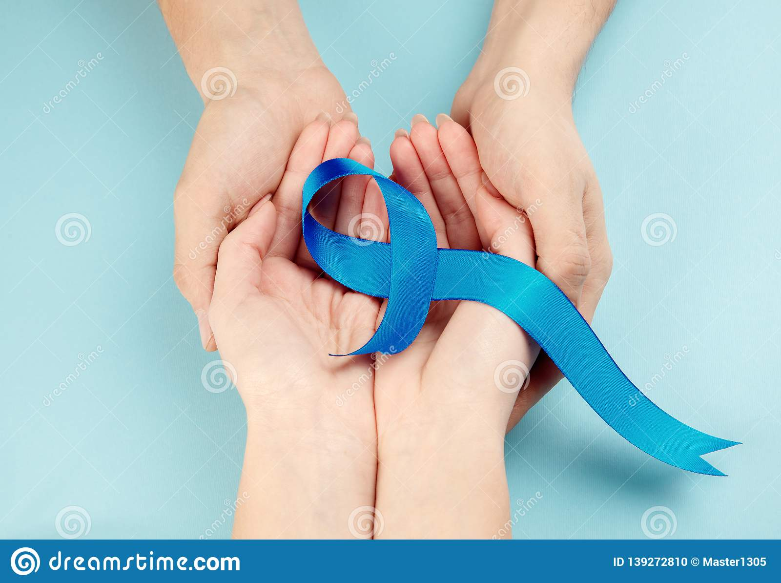 Blue ribbon symbolic of prostate cancer awareness campaign and men`s health in November