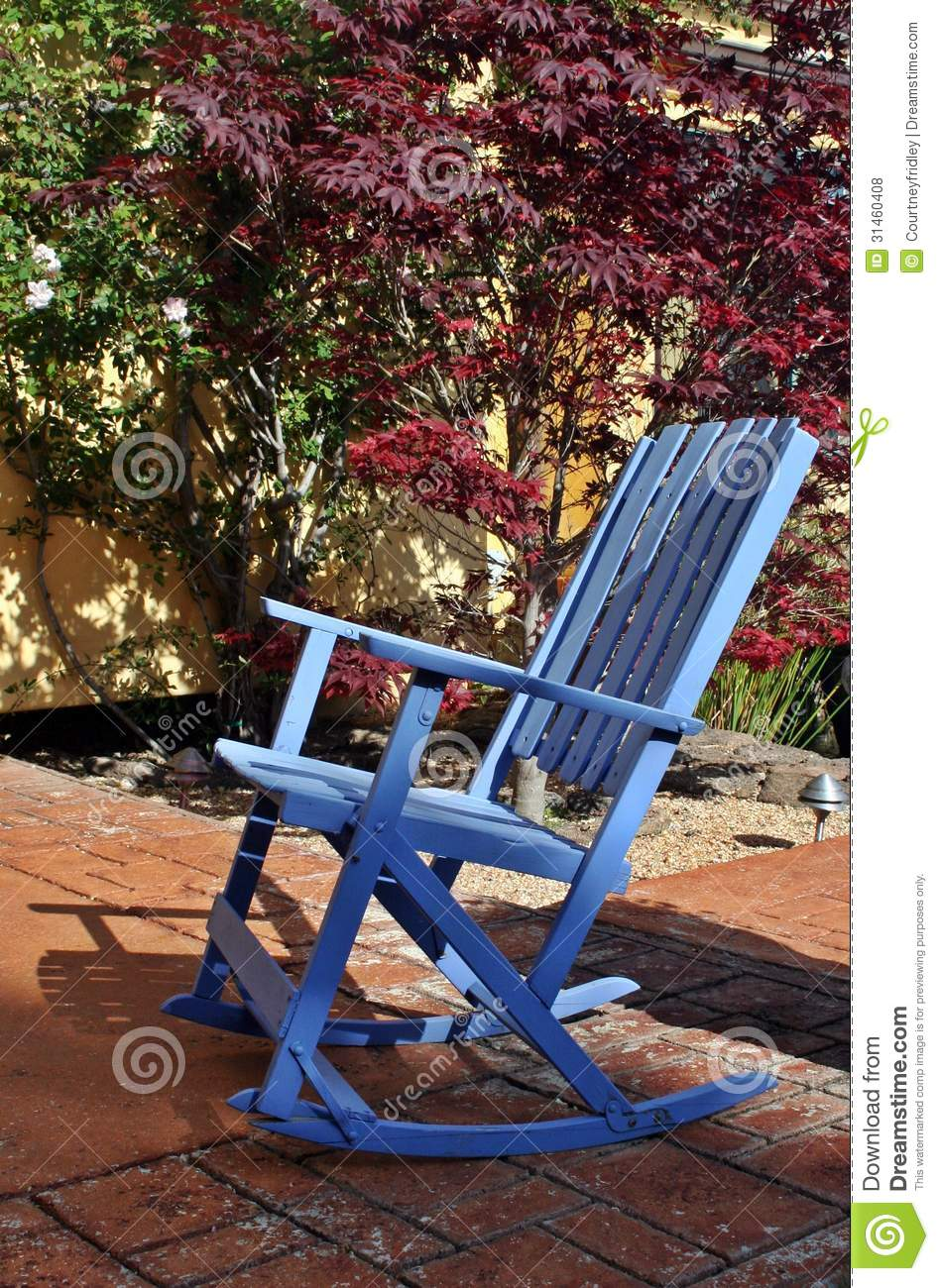 Blue Rocking Chair On A Stone Patio Royalty Free Stock Photos - Image ...