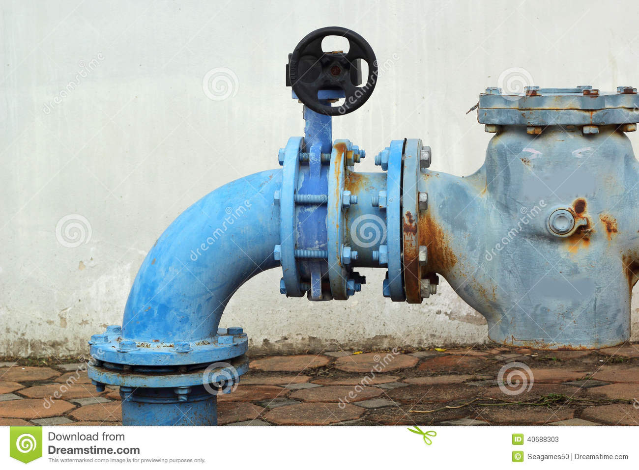 Steel Water Pipes : Blue rusty metal industrial water pipes with a valve