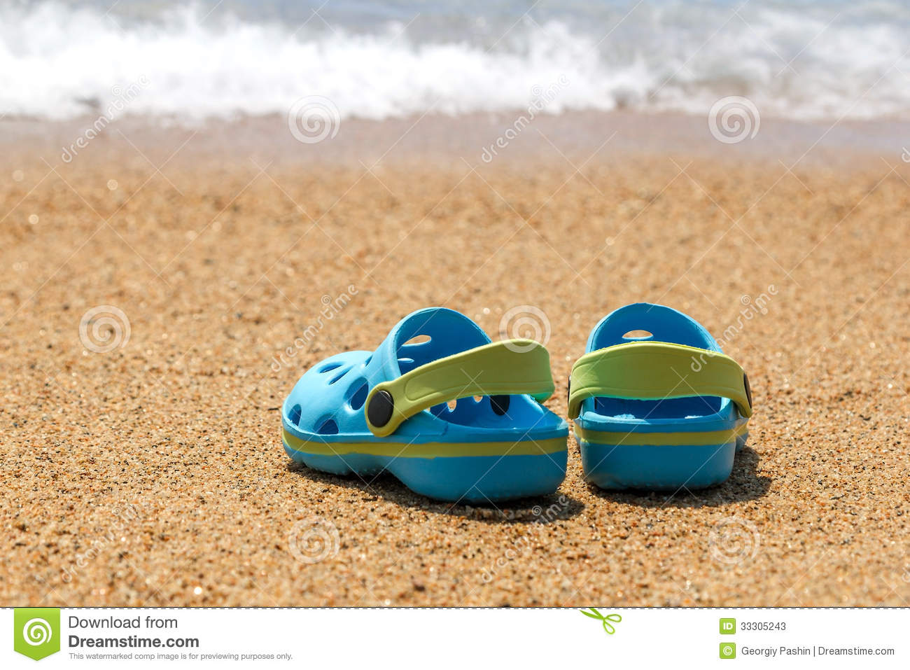 017921ed2 Blue Sandals Slippers On The Sand Stock Image - Image of locations ...