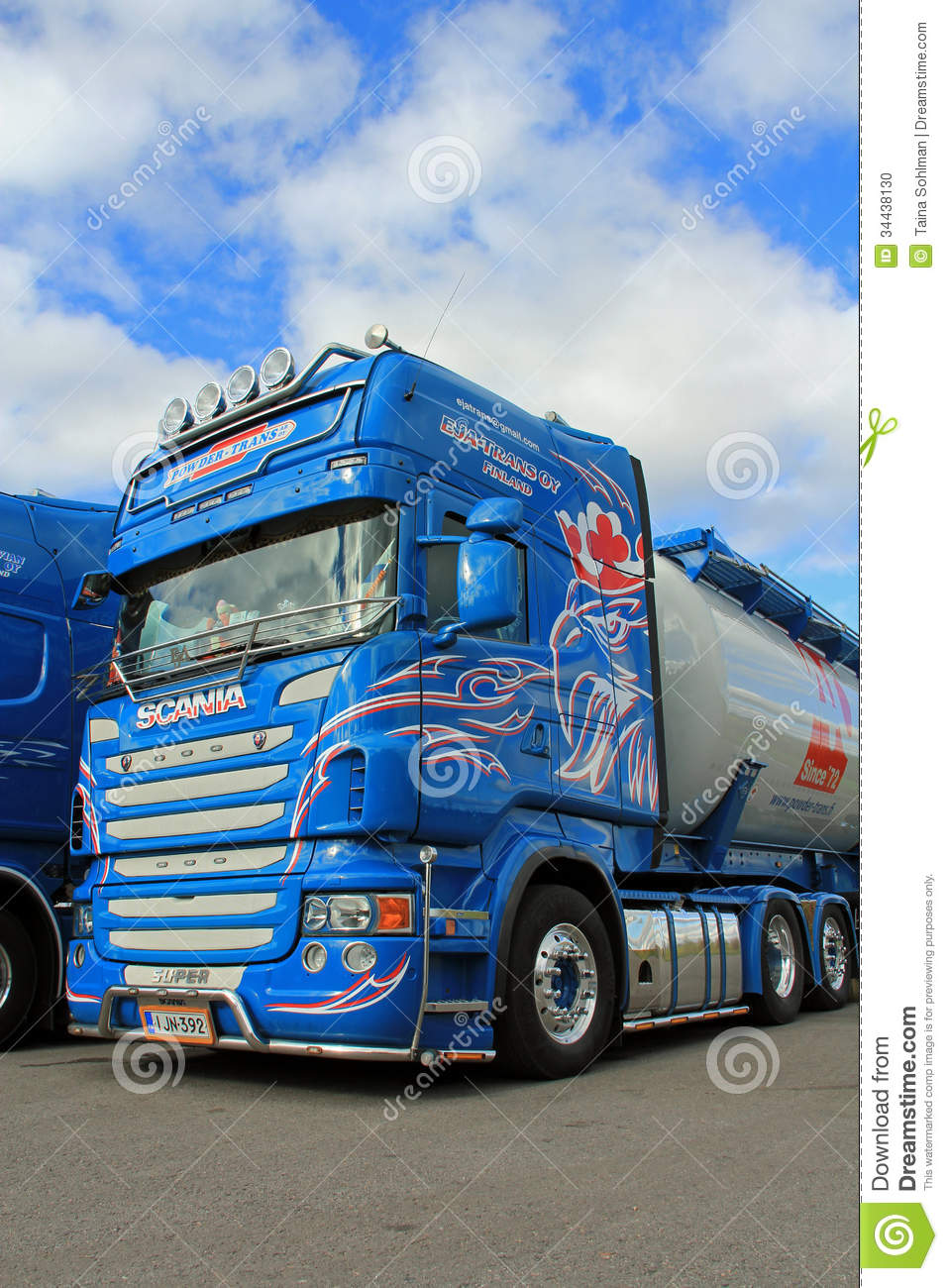 Blue Scania Truck Detail With Blue Sky And Clouds