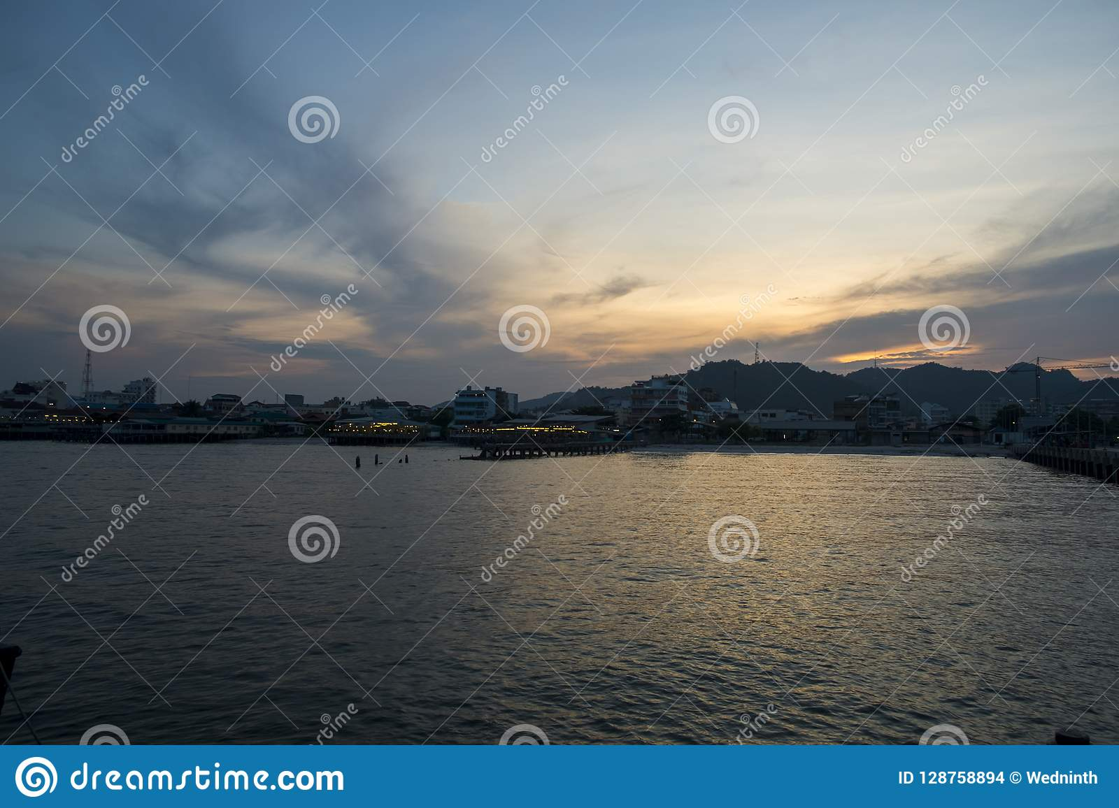 Blue sea and clouds on sky with water surface and sunlight reflections