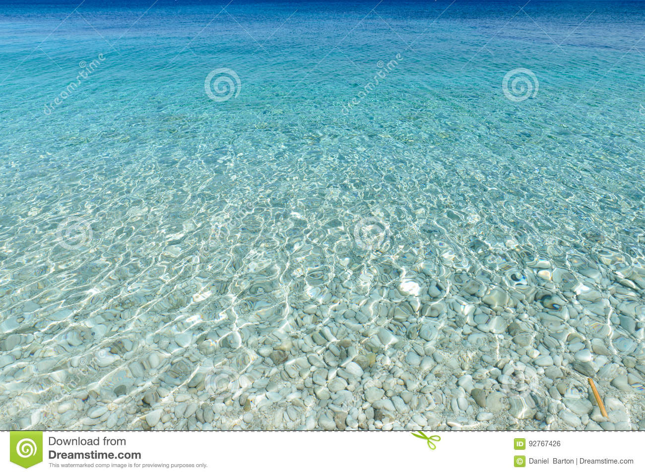Blue sea with pebbles