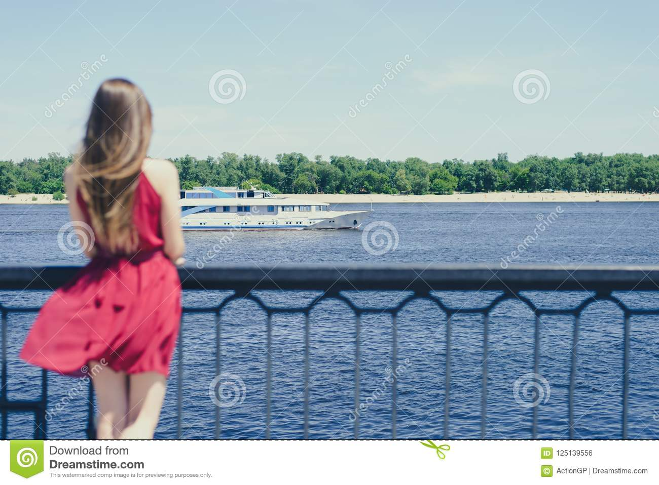 Blue sea sky life sails-man cry day dream sad dreamy lady in red dress concept. Rear back behind view photo portrait of beautiful