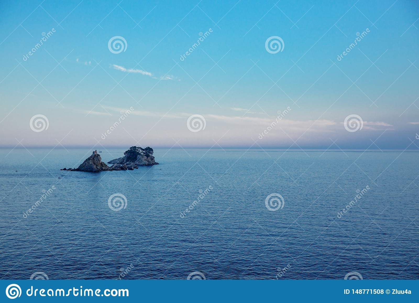 Blue Sea Water And Soft Blue And Pink Sky Sunset On Sea
