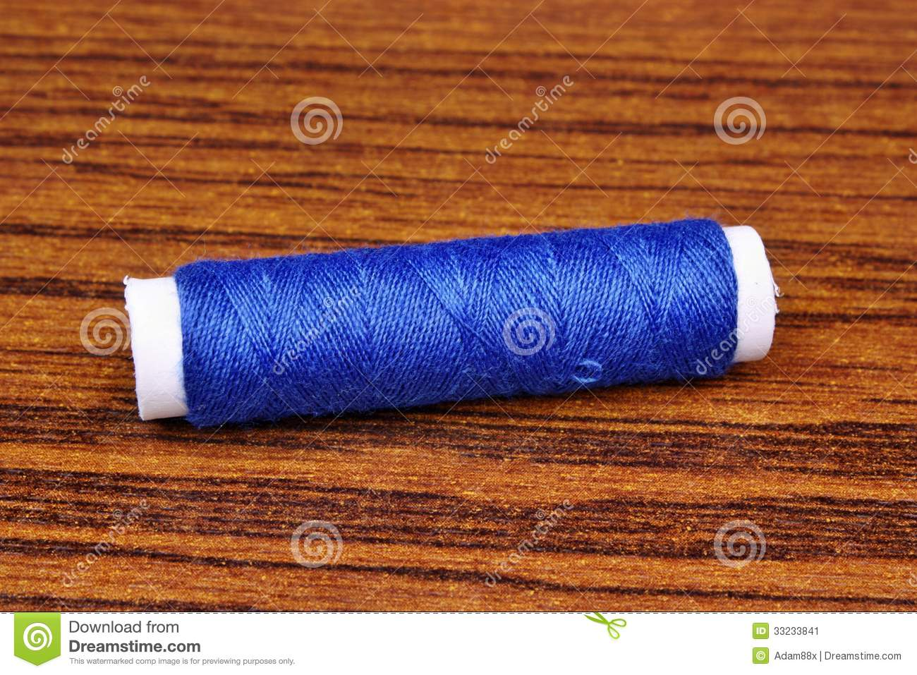 Blue sewing thread stock image