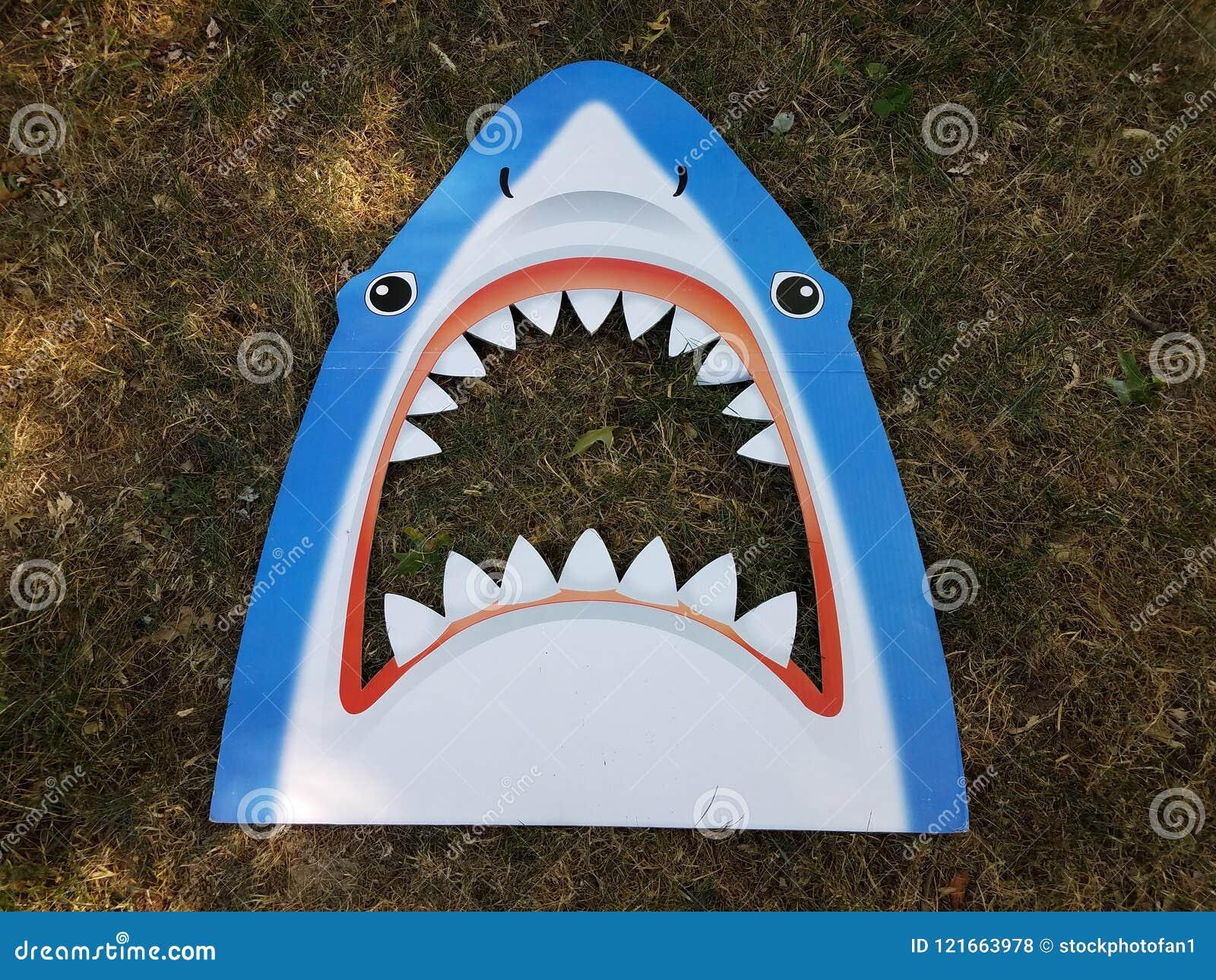 Blue shark head with teeth on grass