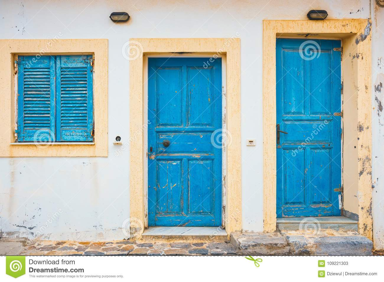 Www Country Door Com.Blue Shutters And Doors On A White Wall Stock Image Image