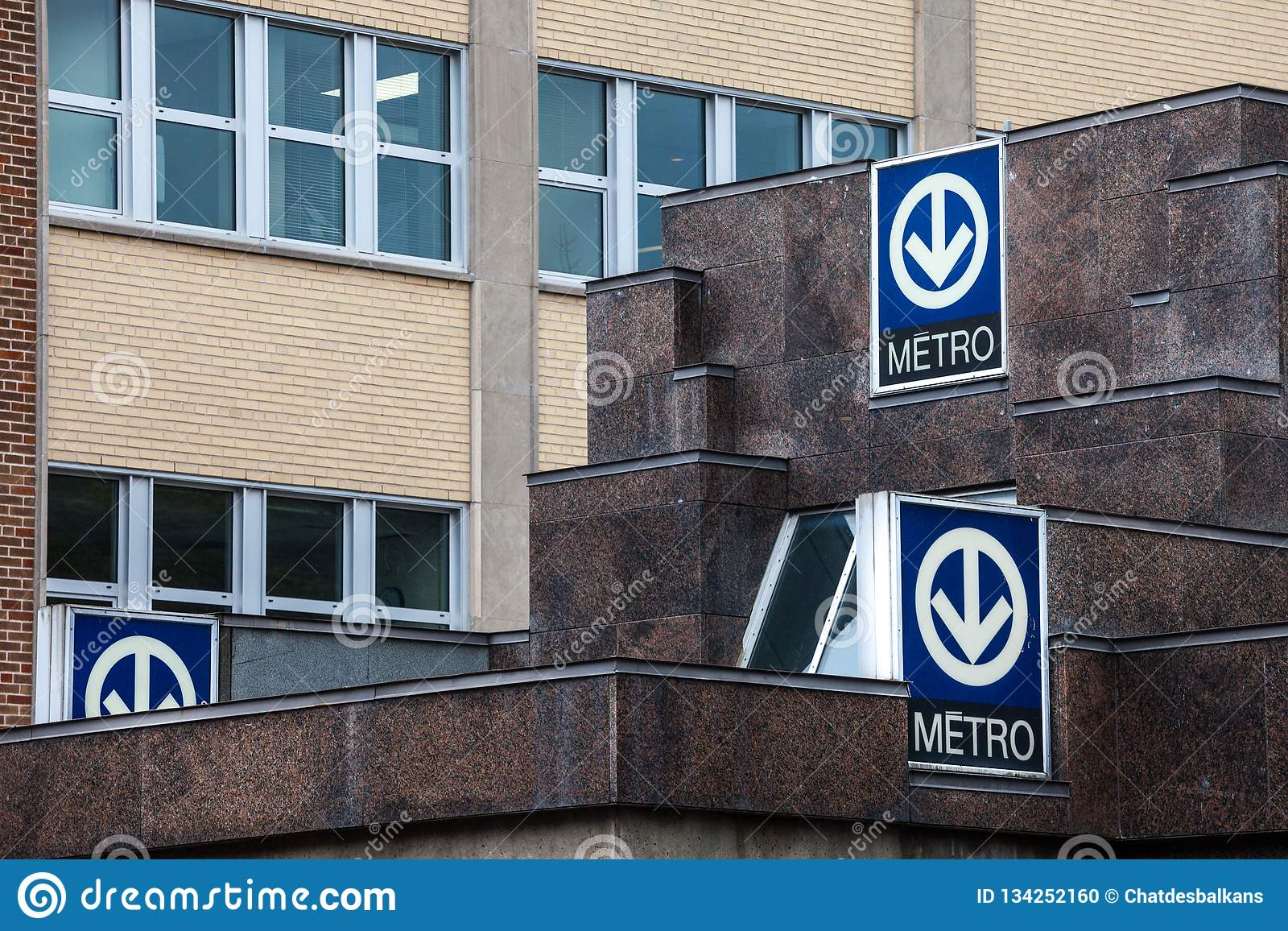 Blue Signs indicating a subway station with its distinctive logo on the Montreal metro system, managed by the STM