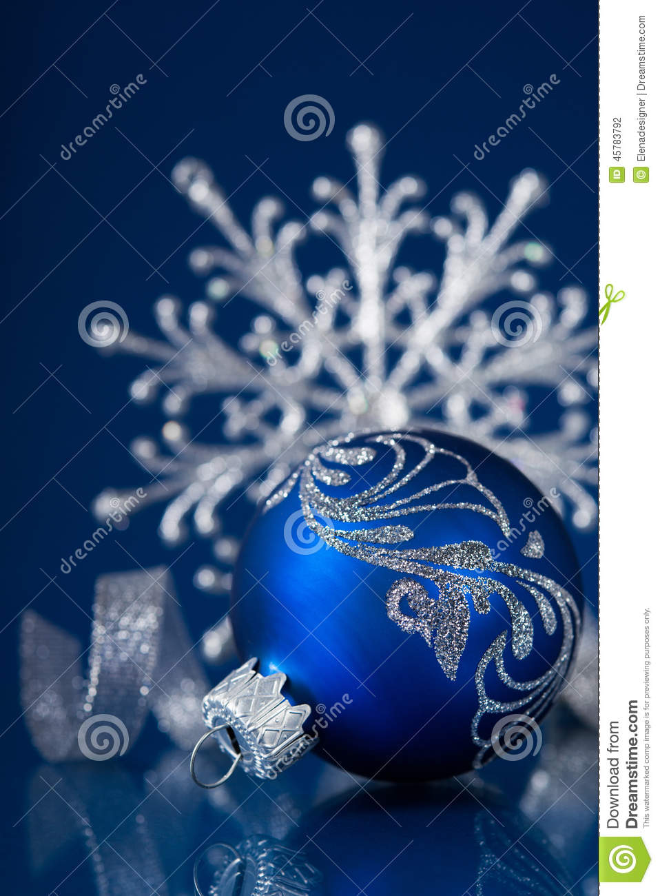 blue and silver christmas ornaments on dark blue xmas background with space for text
