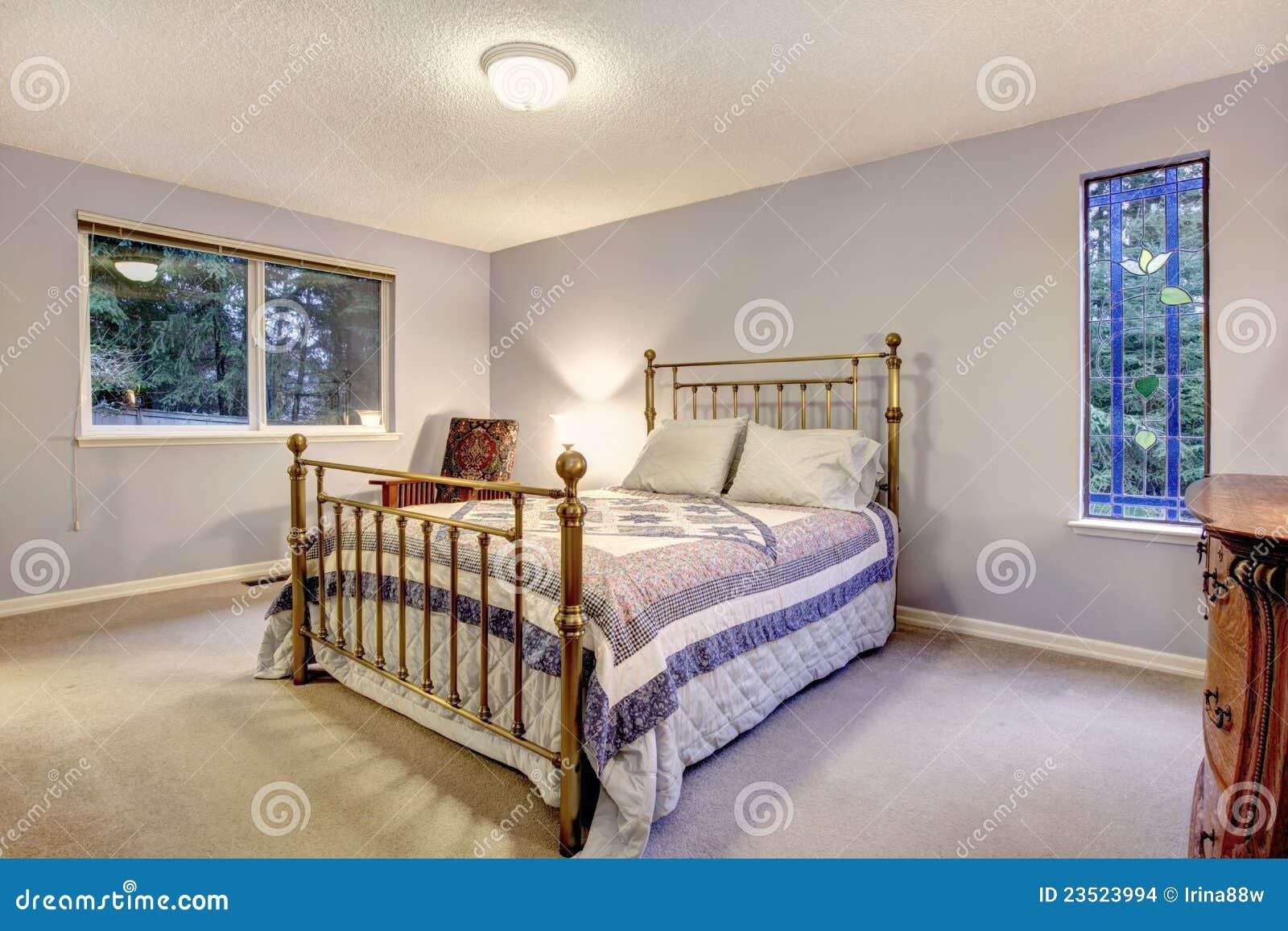 Simple blue bedroom with metal bed