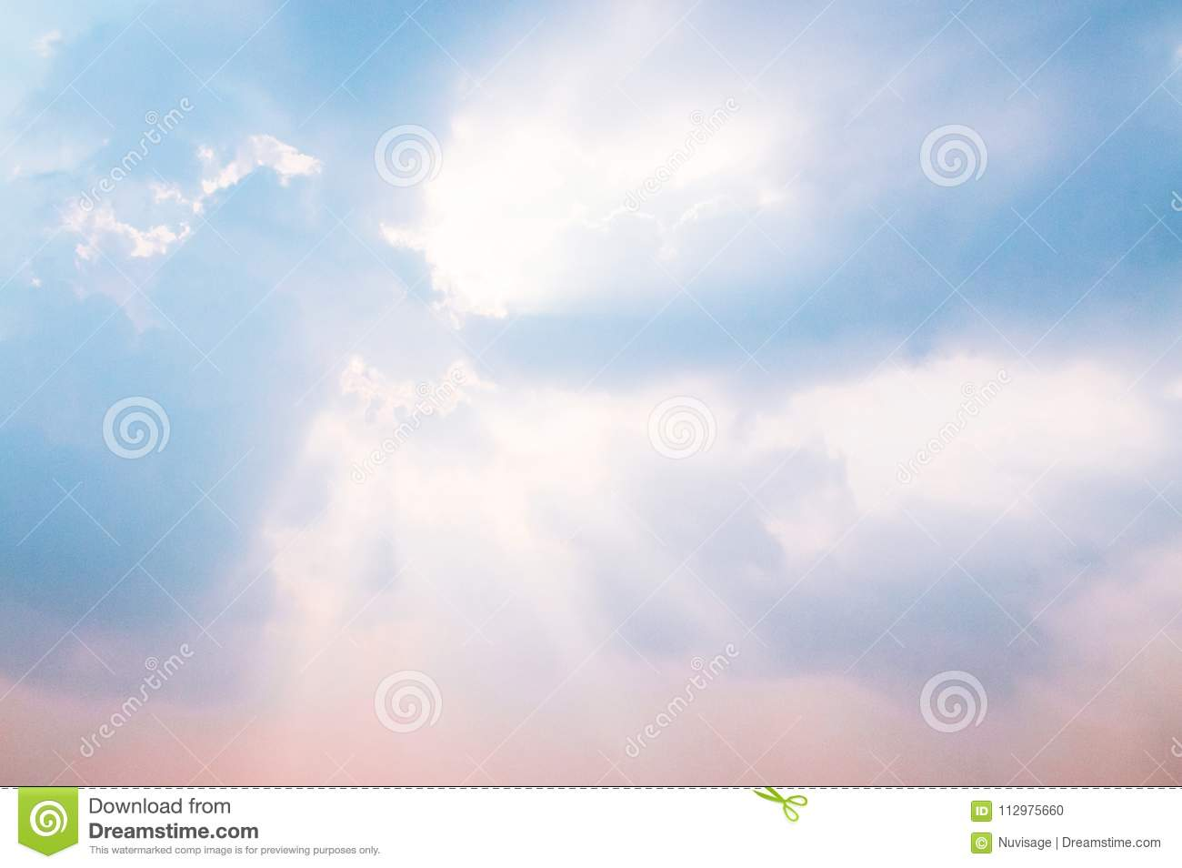 Blue sky and clouds with sun beam god light behind clouds