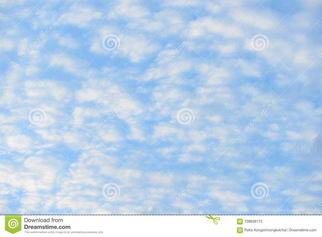 Blue sky with fluffy clouds, close-up background