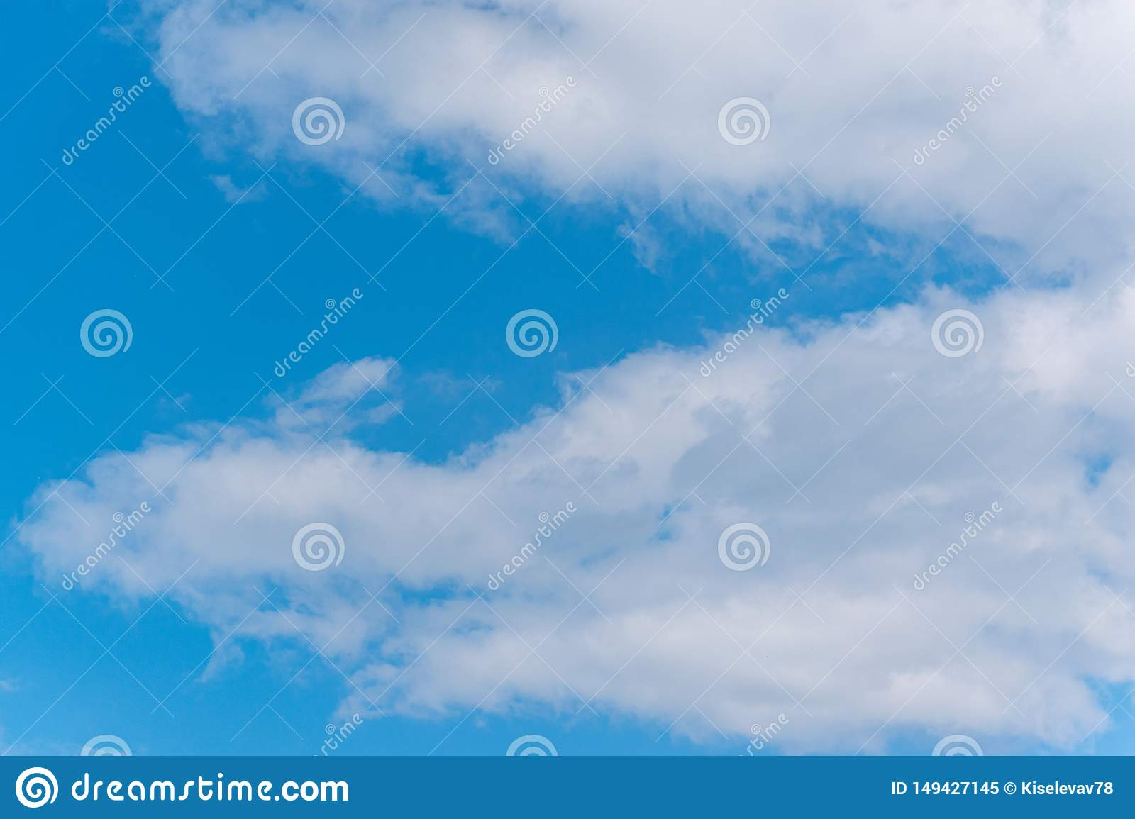 Blue sky with fluffy clouds. Natural landscape. Spring nature scene