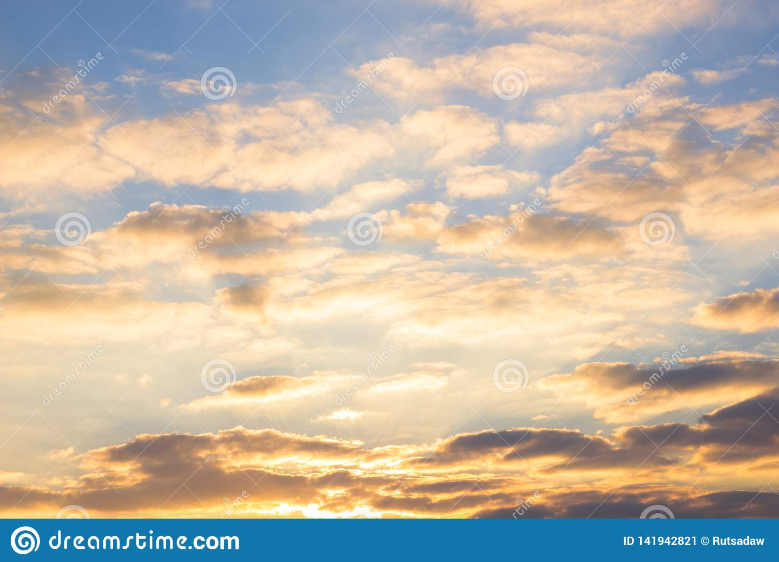 Blue sky and golden clouds at beautiful sunrise