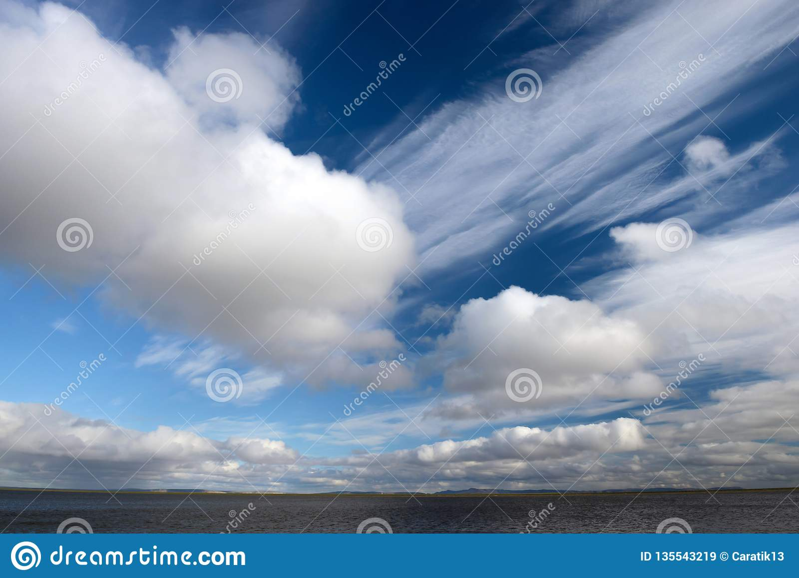 Blue sky with huge fluffy clouds closeup