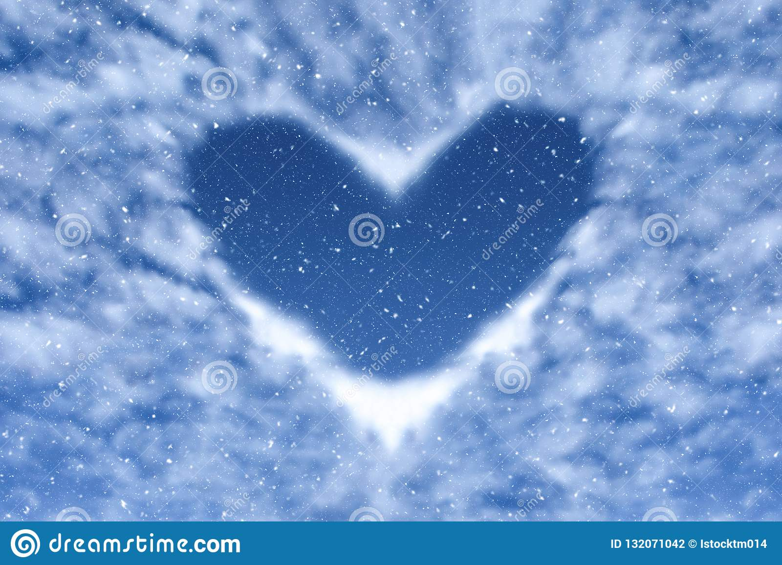Blue sky with snow and clouds in heart shape. Happy and love background.
