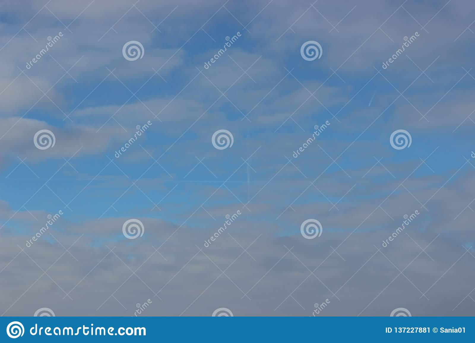 Blue sky and white clouds on a Sunny winter day. the traces of the planes
