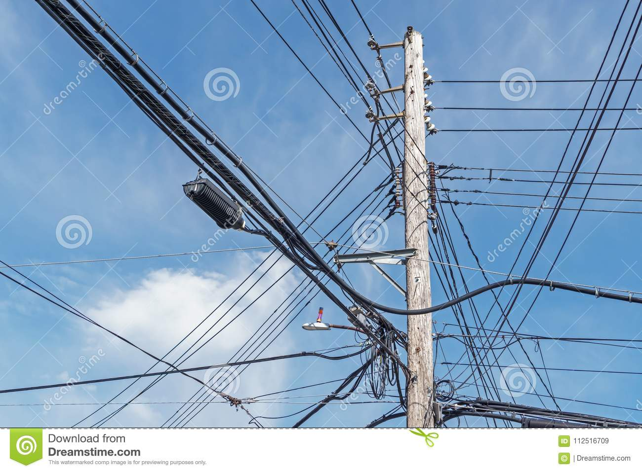 Distribution Capacitor Wiring Online Schematics Diagram Power Cap Tall Wooden Pole With Lots Of Overhead Wires Coiled Cables Ac 4