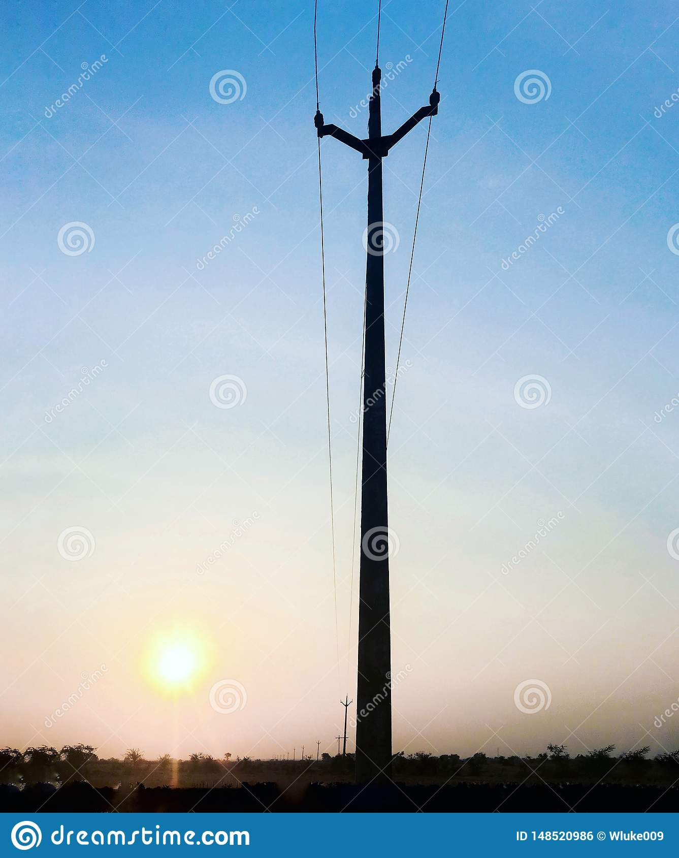 Blue sky with yellow sun and pole