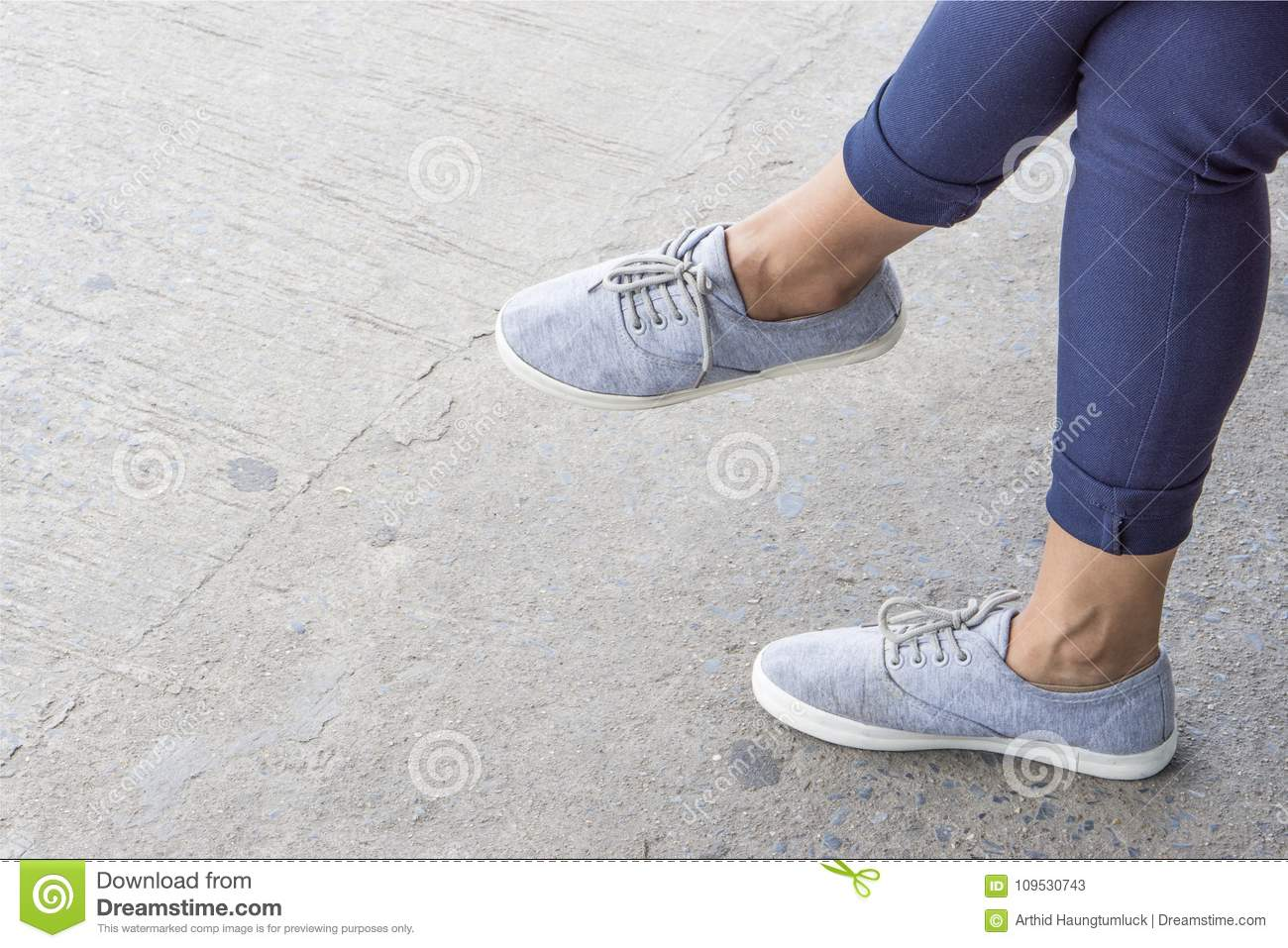 blue sneakers on asian female feet. stock image - image of city