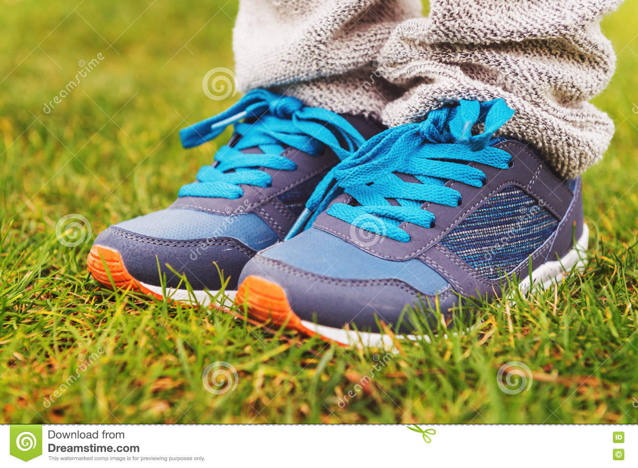 Blue sneakers on child s feet